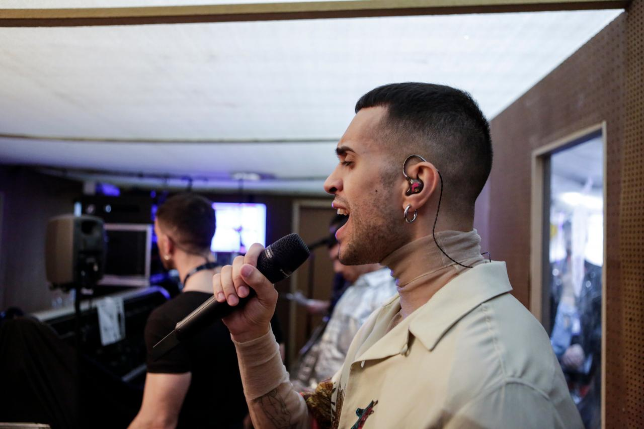 Italy's Mahmood checking his in-ears before he takes the stage for his rehearsal